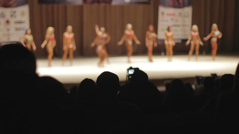Spectators watching bodybuilding and physique competition, participants lineup Footage