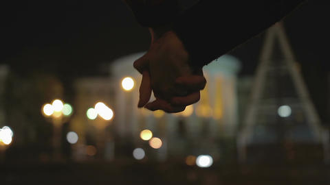 Friends interlocking hands tightly, showing determination to protect each other Footage
