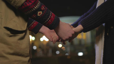 Couple in love holding hands before goodbye, breaking up, heartbreak story Footage