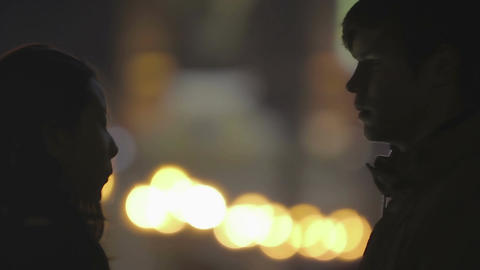 First timid kiss of teenage couple at romantic date, happy love story beginning Live Action