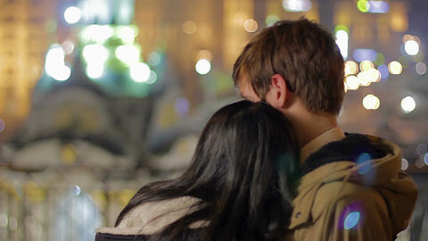 Loving couple hugging each other and enjoying beautiful night city view, love Footage