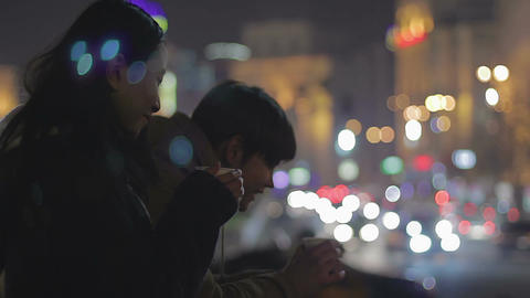 Teenage couple drinking coffee and communicating on street, first date, feelings Live Action