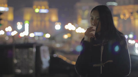 Asian girl drinking tea and relaxing after hard workday, thinking about life Footage
