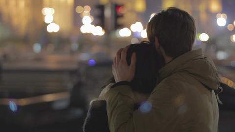 Young happy couple hugging on date, enjoying night city view, relationship Footage