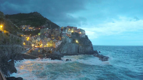 Waves washing rocks near beautiful Positano village in Italy, storm timelapse Footage