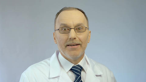 Excitement on happy face of male doctor surprised by good career opportunity Footage