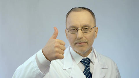 Professional therapist looking confidently at camera, making thumbs-up gesture Footage