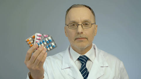 Bunch of pills in doctor's hand, promotion of pharmaceutical industry products Footage