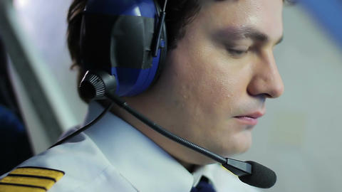Male pilot navigating private airplane, pushing buttons on flight panel, job Footage