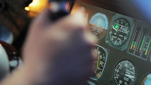 Pilot hands on steering wheel of private airplane, indicators on flight panel Footage