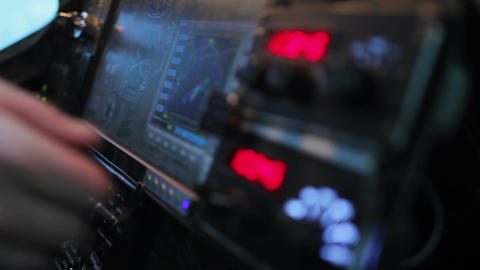 Pilot searching radio frequency on flight panel of airliner, technology Live Action