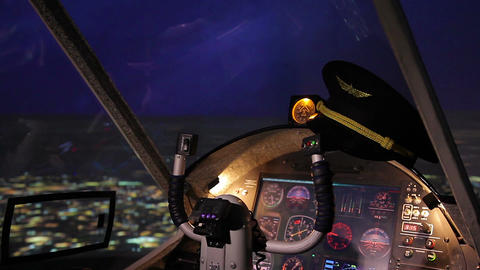 Pilot's hat lying on flight panel in aircraft, aviation school advertisement Live Action