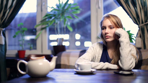 Impatient girl waiting for her boyfriend in cafe Footage