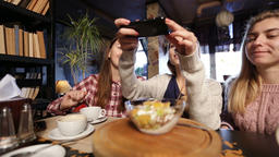 Female friends taking food picture with smartphone Footage