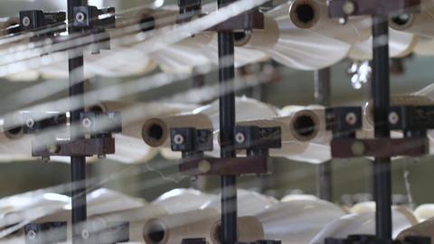 Closeup Operating Spinning Machine with White Thread Bobbins Footage