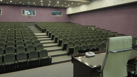 Panorama from Table with Chair to Empty Row with Light Projector Footage