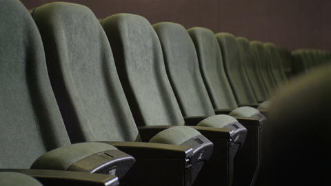 Closeup one Row of Empty Gray Chair in Dark Cinema Hall Footage