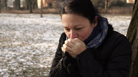 Woman Warming Up Cold Hands Outside Handheld Footage
