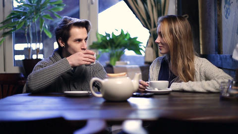 Romantic couple drinking tea at restaurant Footage