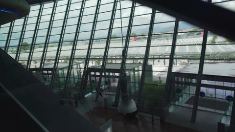 View on airport hall from moving escalator, vacation and travel, tourism Footage