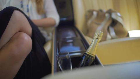 Glamorous woman sitting in expensive car, drinking wine, enjoying trip, relax Footage