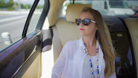 Young woman in sunglasses traveling by car to another city, luxury lifestyle Footage