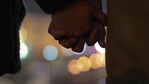Girl and boy standing close with interlocked fingers, first date, true love Footage