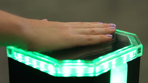 Female palm on innovative identification equipment, biometrics authentication Footage