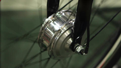 Wheel of bicycle rotating at technical maintenance workshop, cycling hobby Footage