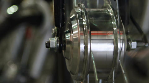 Shiny steel wheel spinning, vehicle production and maintenance business, closeup Footage