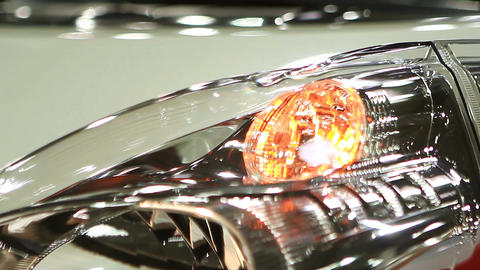 Headlamp of new auto blinking at showroom, warning light signal, car crash Footage