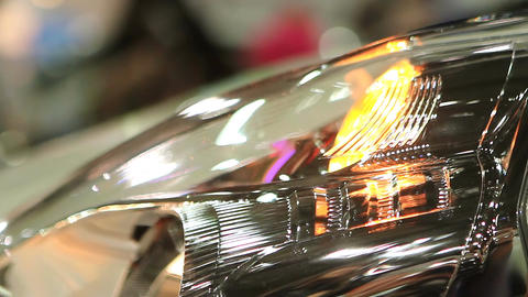Close up of auto headlamp, hazard warning lights blinking, car breakdown signal Footage