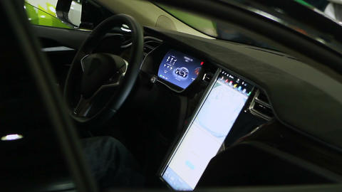 Man sitting in car with advanced touch screen control panel, technical progress Live Action