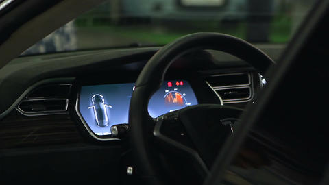 Wealthy man's hands on steering wheel, testing car before purchase, showroom Footage