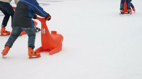 Many children having fun on skating rink, enjoying active rest on ice in winter Footage