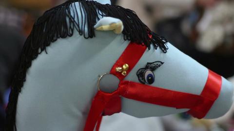 Little boy enjoying a ride on funny toy horse, happy childhood, kindergarten Footage