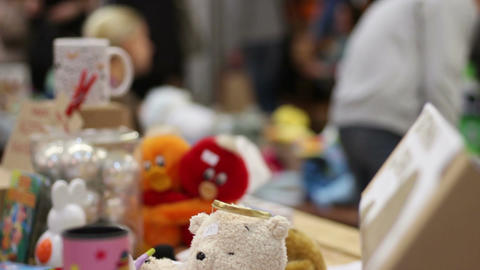 People selling handmade toys at trade fair, raising charity funds for sick kids Footage