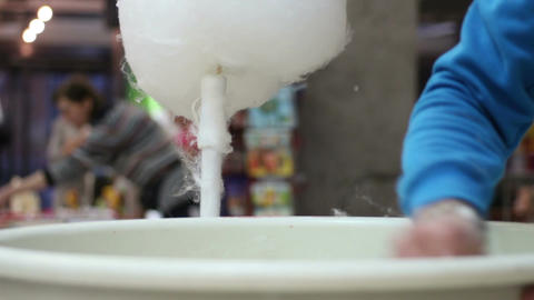 Cotton candy vendor cleaning dish, sanitary control, excessive sugar consumption Live Action
