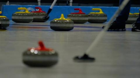 Curling stones on ice Footage