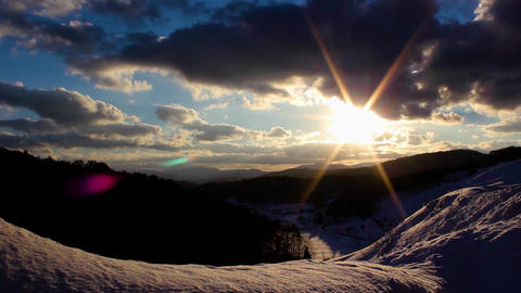 The setting sun from the snowy mountains Footage