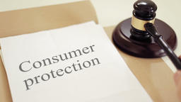 Consumer protection written on legal documents with gavel Footage
