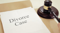 Divorce case written on legal documents with gavel Footage