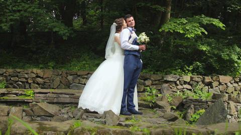 The bride standing behind groom and hugs him Footage