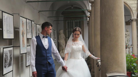 bride and bridegroom in a beautiful building Live Action