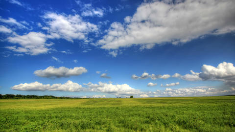 4K. Timelapse clouds over the green field. FULL HD,... Stock Video Footage
