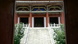 Enter yard from door of Chinese ancient buildings,saw statue of Bodhisattva Mait Footage
