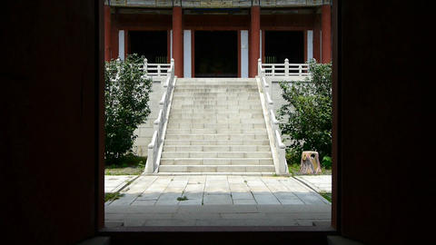 Enter yard from door of Chinese ancient temple buildings Footage