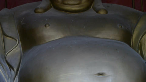 Smiling pregnant Maitreya Buddha Stock Video Footage