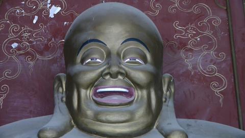 Smiling pregnant Maitreya Buddha Stock Video Footage