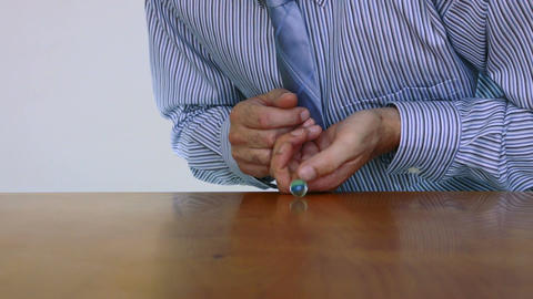 Businessman Shoots Marble Imagination Stock Video Footage